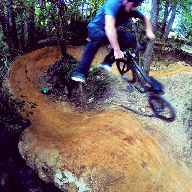 Roller whip in the woods. @fitbikeco @bellbikehelmets @danscompinstagram @duobrand @gsportbmx @almond_footwear photo: @crandallfbm