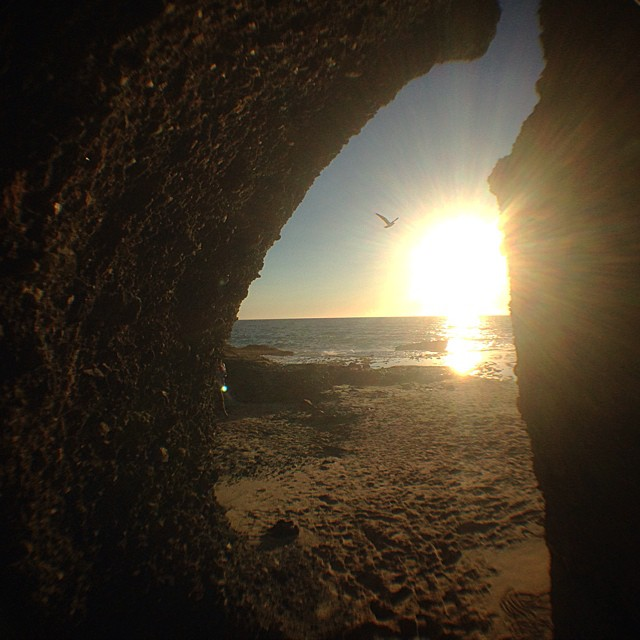 Beach cave sunset