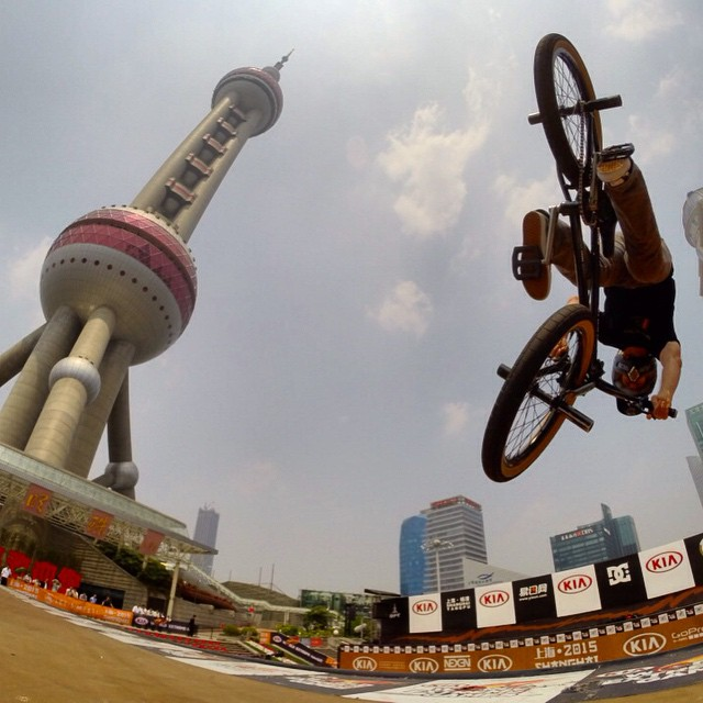 Over in Shanghai judging the Kia World Extreme Games this week. The location of the vert ramp doesn't seem real. @bmxdmc diving back in from a table air.